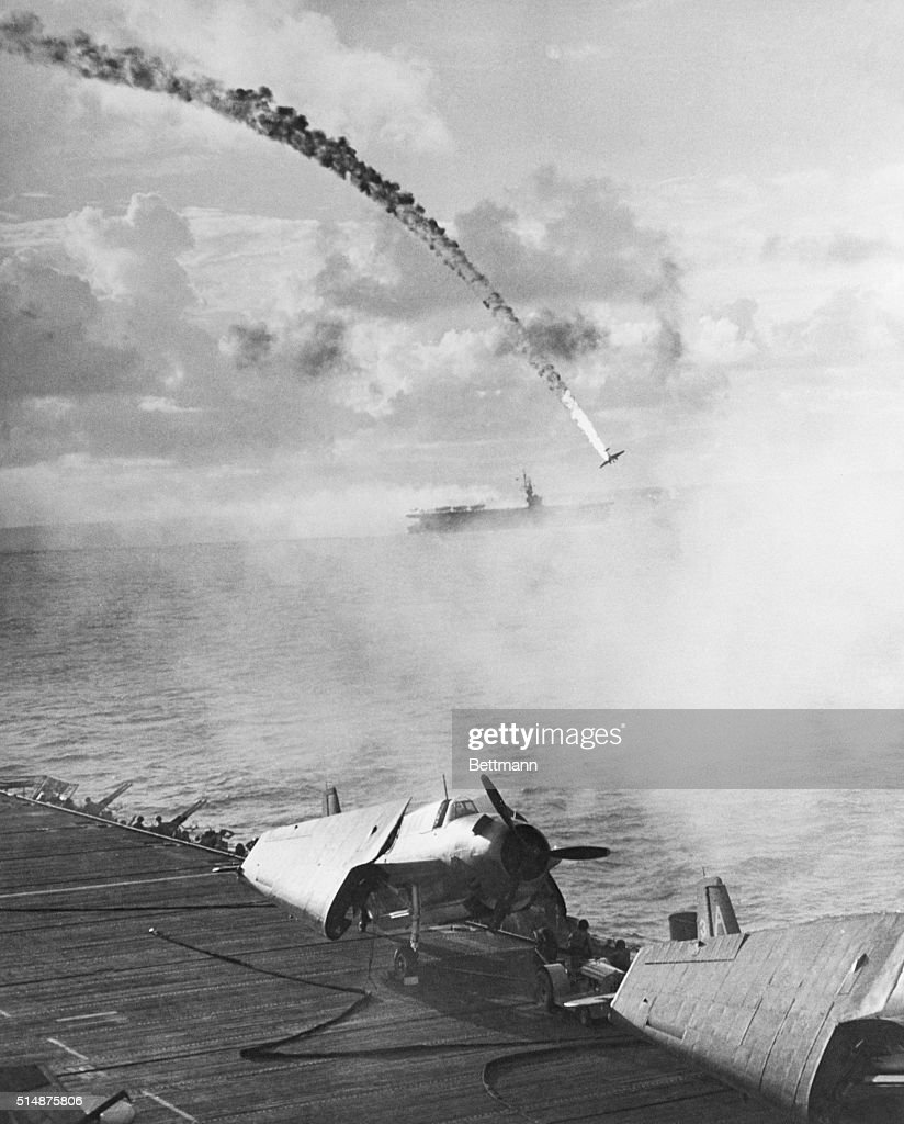 A Japanese fighter plane on a kamikaze mission is shot down by anitaircraft guns on an aircraft carrier | Location Near Saipan