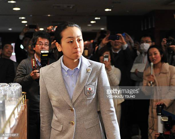 Japanese figure skater Mao Asada arrives a conference room to speak before prerss in Tokyo as she returned from the Winter Olympic Games in Sochi on...