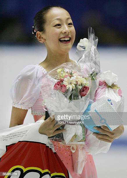 Japanese figure skater Mao Asada is all smile after her free skating of women's singles event in the Japan Figure Skating Championships in Tokyo 25...