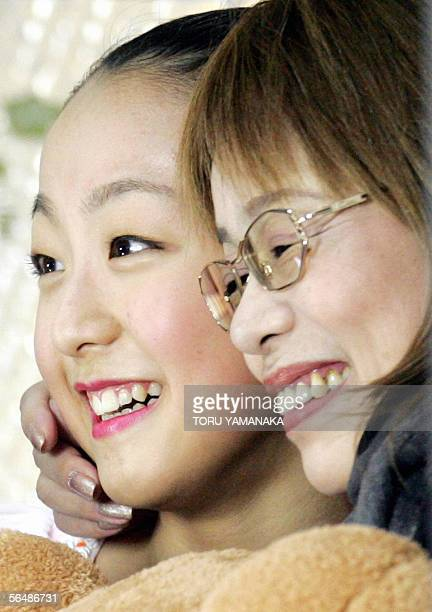 Japanese figure skater Mao Asada is all smile with her coach Machiko Yamada after her free skating of women's singles event in the Japan Figure...