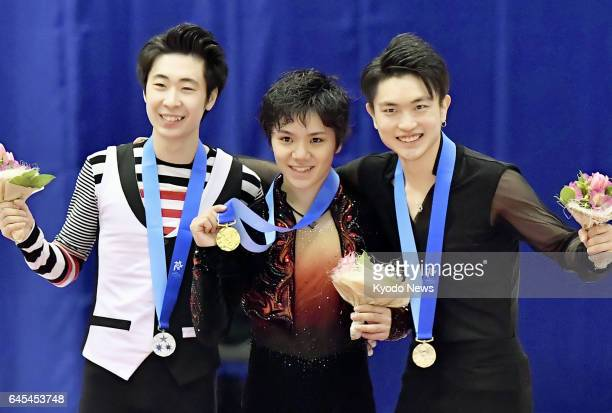 Japanese figure skater Shoma Uno poses with his gold medal on the podium at the Asian Winter Games in Sapporo on Feb 26 alongside silver medalist Jin...