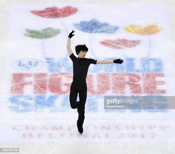 Japanese figure skater Yuzuru Hanyu works out during an official practice session in Helsinki on March 28 a day before the start of the world...