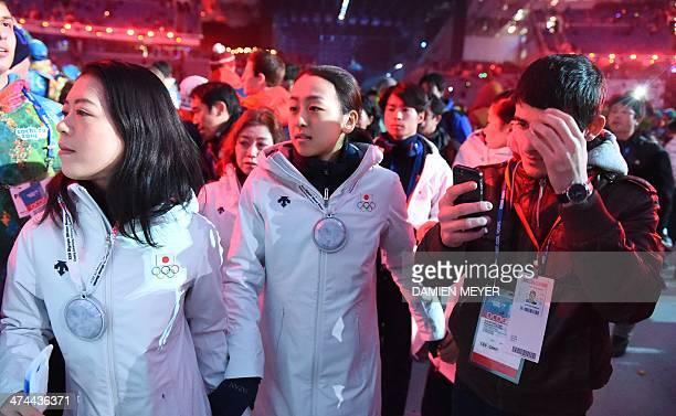 Japanese figure skaters Mao Asada and Akiko Suzuki attend the Closing Ceremony of the Sochi Winter Olympics at the Fisht Olympic Stadium on February...