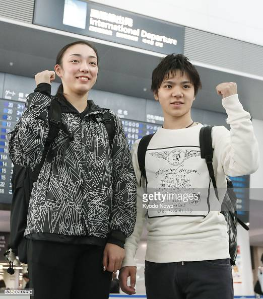 Japanese figure skaters Rika Hongo and Shoma Uno pose for photos at Chubu airport in central Japan on Feb 13 before leaving for South Korea to...