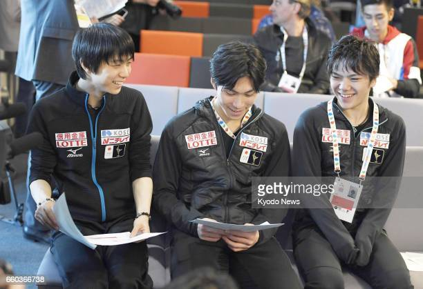 Japanese figure skaters Yuzuru Hanyu Keiji Tanaka and Shoma Uno participate in the draw at the world championships in Helsinki on March 29 to decide...