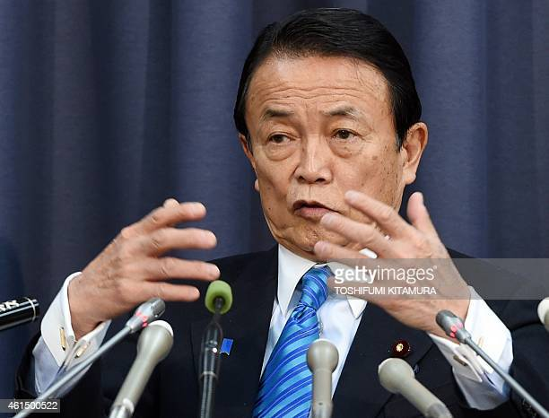 Japanese Finance and Deputy Prime Minister Taro Aso answers a question during his press conference at the finance ministry after prime minister...
