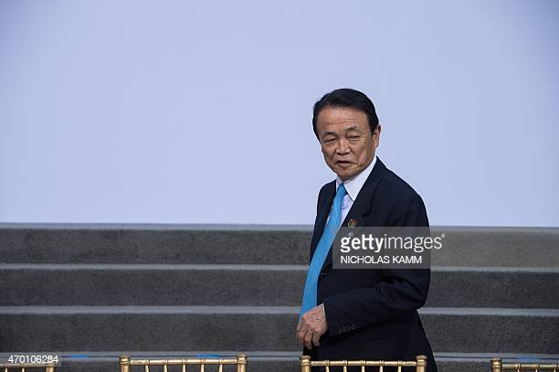 Japanese Finance Minister Taro Aso arrives for the G20 family photo at the IMF/WB Spring Meetings in Washington DC on April 17 2015 AFP...