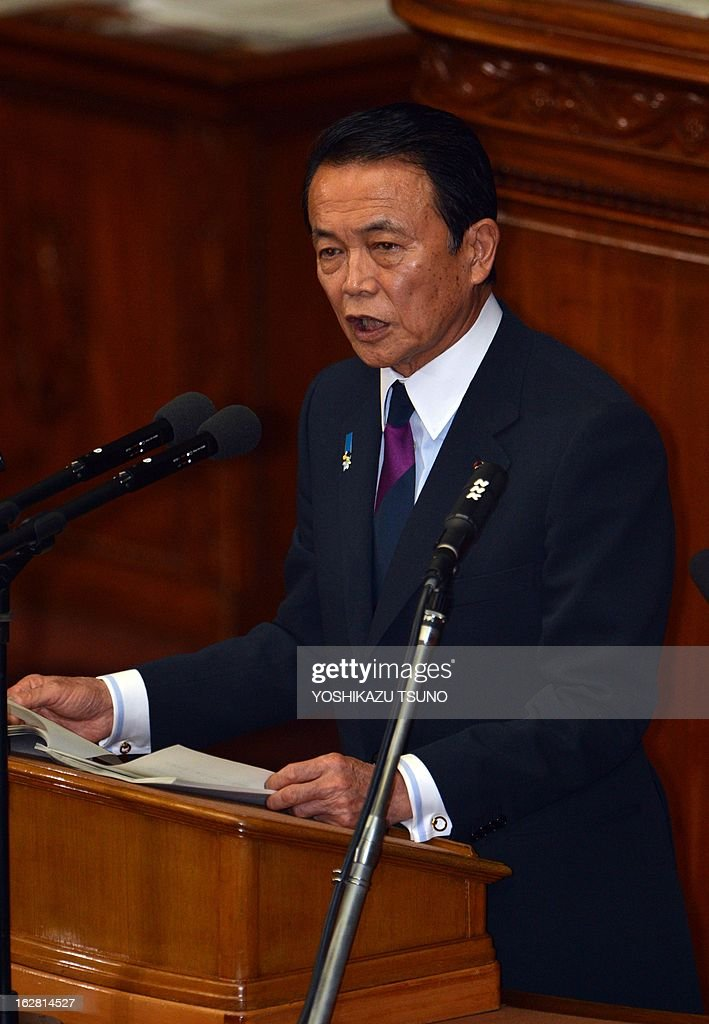 Japanese Finance Minister Taro Aso delivers a financial speech at the Lower House's plenary session at the National Diet in Tokyo on February 28, 2013. Faced with a territorial dispute with China, Prime Minister Shinzo Abe quoted former British prime minister Margaret Thatcher stressing the rule of law over the 1982 Falklands war. AFP PHOTO / Yoshikazu TSUNO