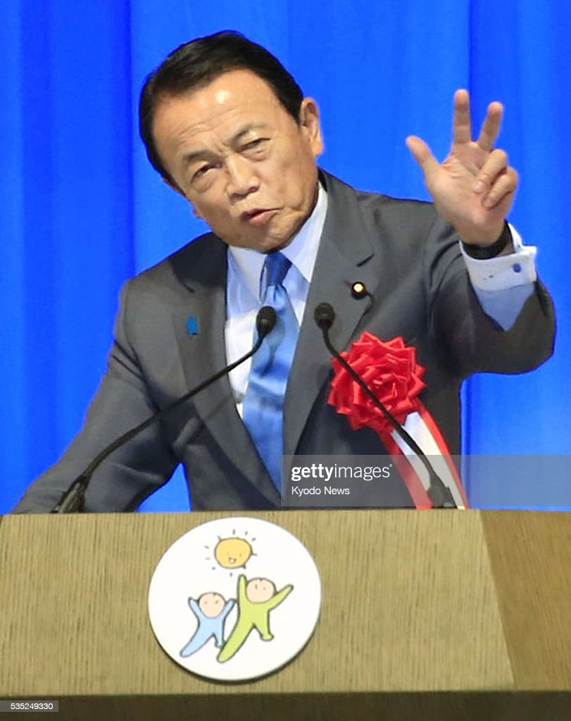 Japanese Finance Minister Taro Aso speaks at a Liberal Democratic Party meeting in Toyama, central Japan, on May 29, 2016. Aso said Prime Minister Shinzo Abe would need to dissolve the House of Representatives for a general election if he pushes back a 2-percentage-point consumption tax hike scheduled for April 2017, a day after meeting with Abe and other top party officials on the possibility of postponing the tax hike until October 2019.