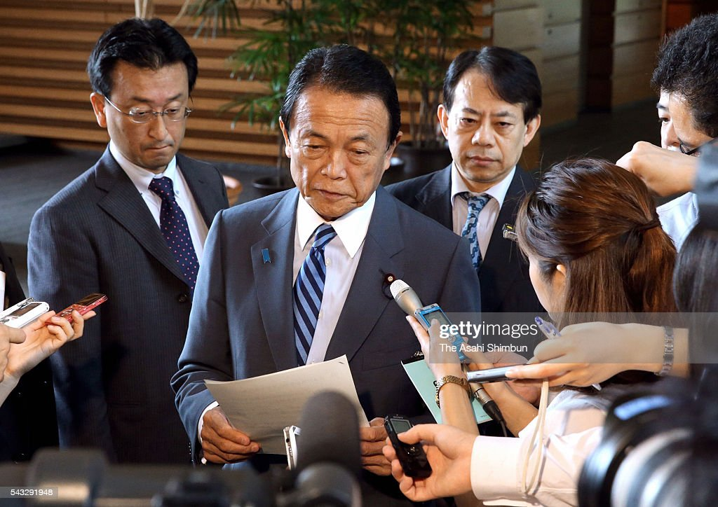 Japanese Finance Minister <a gi-track='captionPersonalityLinkClicked' href=/galleries/search?phrase=Taro+Aso&family=editorial&specificpeople=559212 ng-click='$event.stopPropagation()'>Taro Aso</a> speaks to media reporters after his meeting with Japanese Prime Minister <a gi-track='captionPersonalityLinkClicked' href=/galleries/search?phrase=Taro+Aso&family=editorial&specificpeople=559212 ng-click='$event.stopPropagation()'>Taro Aso</a> and Bank of Japan Deputy Governor Hiroshi Nakaso at Abe's official residence on June 27, 2016 in Tokyo, Japan. The government and the central bank held a meeting to measure the impact of the 'Brexit'.