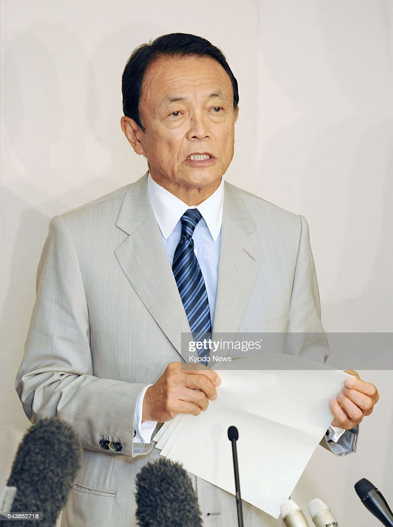 Japanese Finance Minister <a gi-track='captionPersonalityLinkClicked' href=/galleries/search?phrase=Taro+Aso&family=editorial&specificpeople=559212 ng-click='$event.stopPropagation()'>Taro Aso</a> speaks to reporters in Kyoto on June 30, 2016, after the end of the first-day session of the Committee on Fiscal Affairs of the Organization for Economic Cooperation and Development. The committee started a two-day gathering to prompt more countries to take part in ongoing efforts by 46 nations to impose tougher international rules to prevent tax avoidance by multinational enterprises.