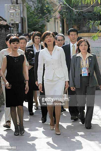 Japanese first lady Akie Abe attends a spouse program to visit Vietnam's standard house on the sidelines of the APEC summit on November 19 2006 in...