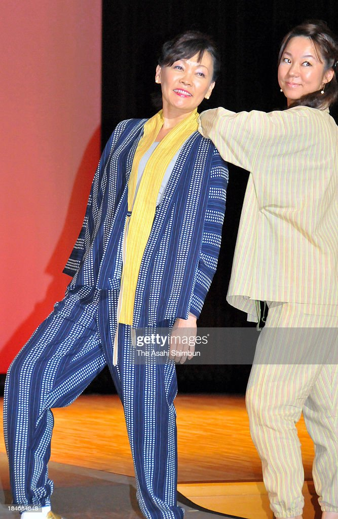 Japanese first lady <a gi-track='captionPersonalityLinkClicked' href=/galleries/search?phrase=Akie+Abe&family=editorial&specificpeople=2042808 ng-click='$event.stopPropagation()'>Akie Abe</a> (L) poses on the runway during an agriculture fashion show she produces, on October 13, 2013 in Nagato, Yamaguchi, Japan. Abe farms rice at her husband's hometown and constituency Yamaguchi prefecture, wishing young people to feel more familiar to agriculture.