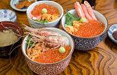 japanese food with fresh shrimp, uni, ikura