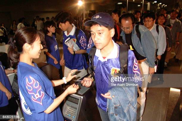 Japanese football fans without match tickets are seen on departure at Kansai International Airport on June 13 1998 in Izumisano Osaka Japan