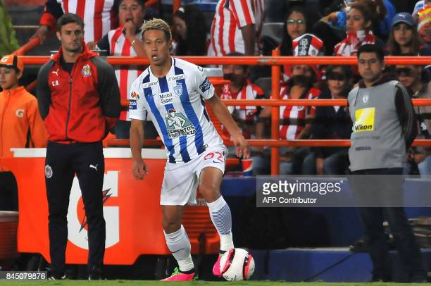 Japanese footballer Keisuke Honda of Pachuca controls the ball during their Mexican Apertura tournament football match against Guadalajara on...