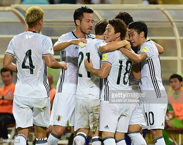 Japanese footballers celebrate a goal by teammate Genki Haraguchi during the 2018 World Cup football qualifying match between Thailand and Japan in...