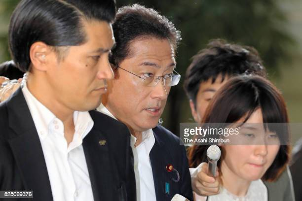 Japanese Foreign and Defense Minister Fumio Kishida enters the Prime Minister's official residence for attending the National Security Council on...