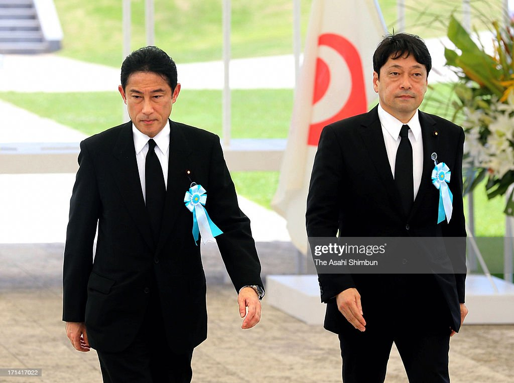 Japanese Foreign Minister Fumio Kishida (L) and Defense Minister Itsunori Onodera leave after attending the peace memorial to mark the 68th anniversary of the termination of the Battle of Okinawa at Okinawa Peace Memorial Park on June 23, 2013 in Itoman, Okinawa, Japan. During the 3-month ground battle at the end of World War II, more than 200,000 people were killed.