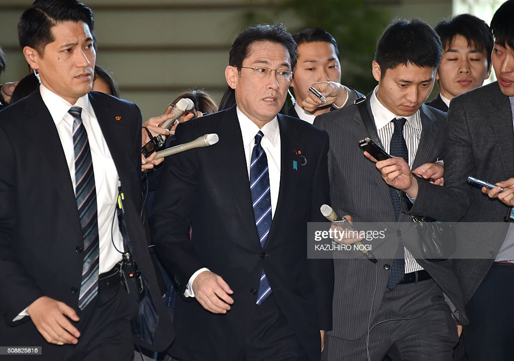 Japanese Foreign Minister Fumio Kishida (C) arrives at the Prime Minister's official residence in Tokyo on February 7, 2016 to attend a National Security Council meeting of top officials including the defence and foreign ministers. Abe condemned North Korea's launch of a long-range rocket on February 7 and said it was a violation of UN Security resolutions. AFP PHOTO / KAZUHIRO NOGI / AFP / KAZUHIRO NOGI
