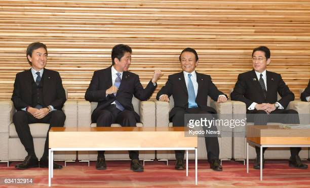 Japanese Foreign Minister Fumio Kishida attends a Cabinet meeting in Tokyo on Feb 7 alongside Nobuteru Ishihara minister in charge of economic...