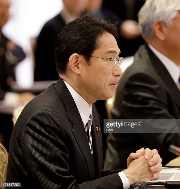 Japanese Foreign Minister Fumio Kishida attends a meeting with representatives of the United States during the USJapan Security Consultative...