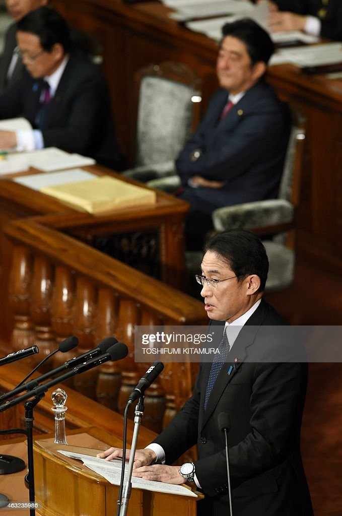 Japanese Foreign Minister <a gi-track='captionPersonalityLinkClicked' href=/galleries/search?phrase=Fumio+Kishida&family=editorial&specificpeople=10093794 ng-click='$event.stopPropagation()'>Fumio Kishida</a> (front) delivers the foreign policy speech at the lower house of the parliament in Tokyo on February 12, 2015. Prime Minister Abe and his cabinets, foreign minister <a gi-track='captionPersonalityLinkClicked' href=/galleries/search?phrase=Fumio+Kishida&family=editorial&specificpeople=10093794 ng-click='$event.stopPropagation()'>Fumio Kishida</a>, finance minister Taro Aso and economic, fiscal policy, economic revitalisation minister Akira Amari displayed new policies in the parliament session, the first time since Abe's third cabinet inauguration. AFP PHOTO / TOSHIFUMI KITAMURA