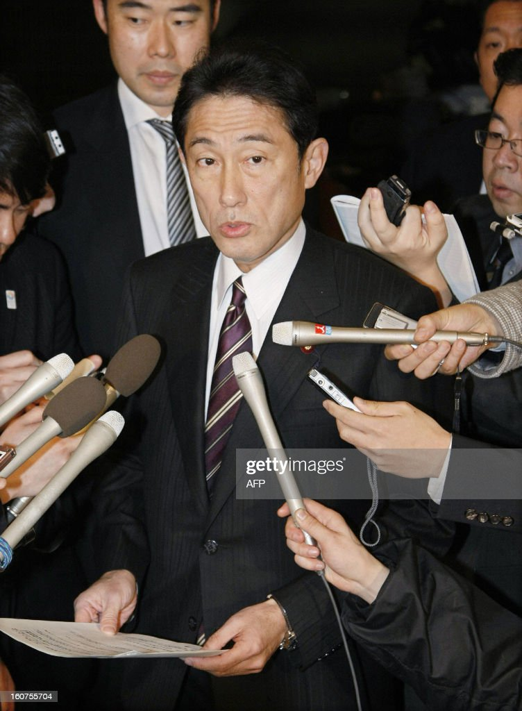 Japanese Foreign Minister Fumio Kishida is surrounded by reporters at his office in Tokyo on February 5, 2013. A Chinese military frigate locked its weapon-targeting radar on a Japanese navy vessel on at least one occasion last month, in an apparent upping of the stakes in a bitter territorial row.
