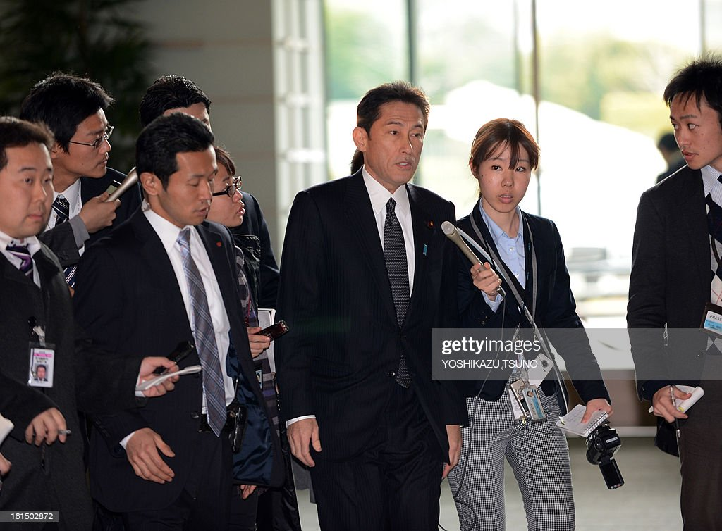Japanese Foreign Minister Fumio Kishida (C) is surrounded by reporters upon his arrival prime minister's official residence to attend the security council meeting in Tokyo on February 12, 2013. North Korea staged an apparent nuclear test of six to seven kilotons in a striking act of defiance that, if confirmed, is sure to trigger global condemnation from enemies and allies alike. AFP PHOTO / Yoshikazu TSUNO