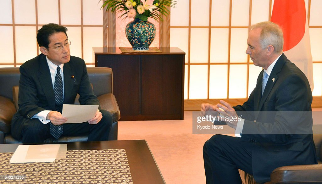 Japanese Foreign Minister <a gi-track='captionPersonalityLinkClicked' href=/galleries/search?phrase=Fumio+Kishida&family=editorial&specificpeople=10093794 ng-click='$event.stopPropagation()'>Fumio Kishida</a> (L) meets with British Ambassador to Japan Tim Hitchens at his ministry in Tokyo on June 27, 2016. Kishida asked Hitchens to help ensure a stable business environment for Japanese companies in Britain, in the wake of the country's vote to leave the European Union.