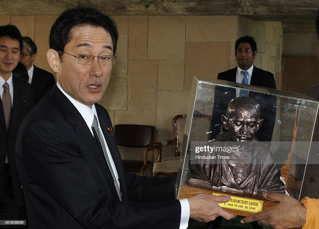 Japanese Foreign Minister <a gi-track='captionPersonalityLinkClicked' href=/galleries/search?phrase=Fumio+Kishida&family=editorial&specificpeople=10093794 ng-click='$event.stopPropagation()'>Fumio Kishida</a> (L) poses with a bust of Mahatma Gandhi presented to him during his visit at Rajghat on January 16, 2015 in New Delhi, India. Two day trip of Kishida, comes on the heels of the crushing win of Prime Minister Shinzo Abe in national polls last month and a visit by Indian Prime Minister Narendra Modi to Japan in August-September. Abe, a right-wing nationalist likened to Modi for his zeal for economic reforms, has been keen to shore up ties with New Delhi to counter an increasingly assertive China.