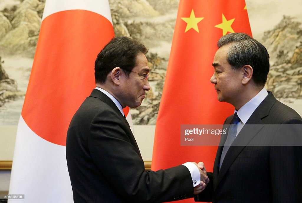 Japanese Foreign Minister Fumio Kishida shakes hands with China's Foreign Minister Wang Yi during a meeting at Diaoyutai State Guesthouse April 30, 2016 in Beijing, China.