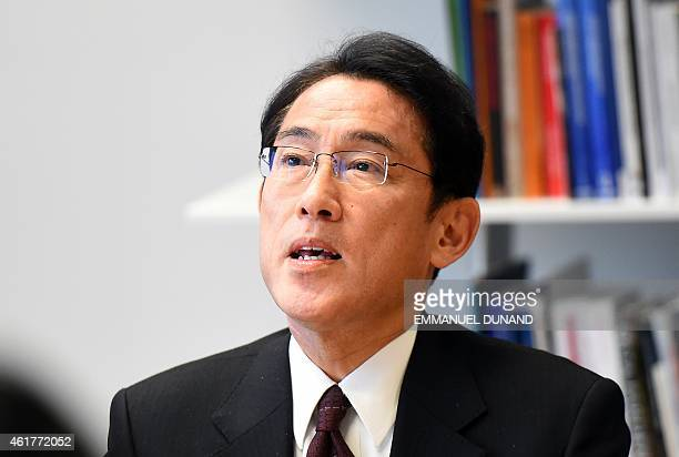 Japanese Foreign Minister Fumio Kishida speaks as he meets with European Commissioner for Trade during a visit at the European Commission...