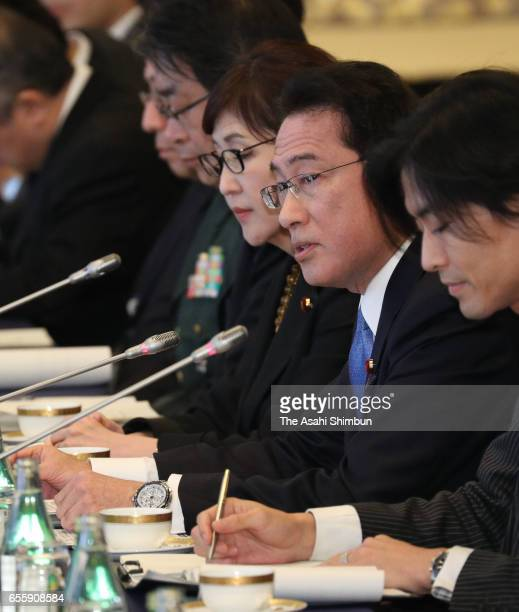 Japanese Foreign Minister Fumio Kishida speaks during the meeting with Russian Defense Minister Sergei Shoigu and Foreign Minister Sergei Lavrov at...