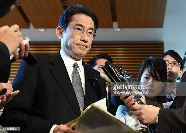 Japanese Foreign Minister Fumio Kishida speaks to journalists right after a cabinet meeting over the crisis involving two Japanese nationals being...