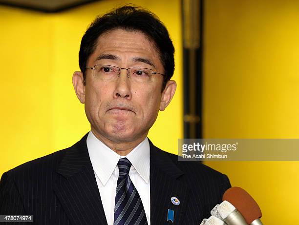 Japanese Foreign Minister Fumio Kishida speaks to media reporters after his meeting with South Korean Foreign Minister Yun Byungse at Iikura Guest...