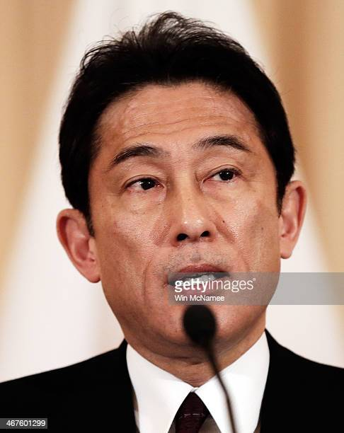 Japanese Foreign Minister Fumio Kishida speaks while delivering a joint statement with US Secretary of State John Kerry at the State Department...