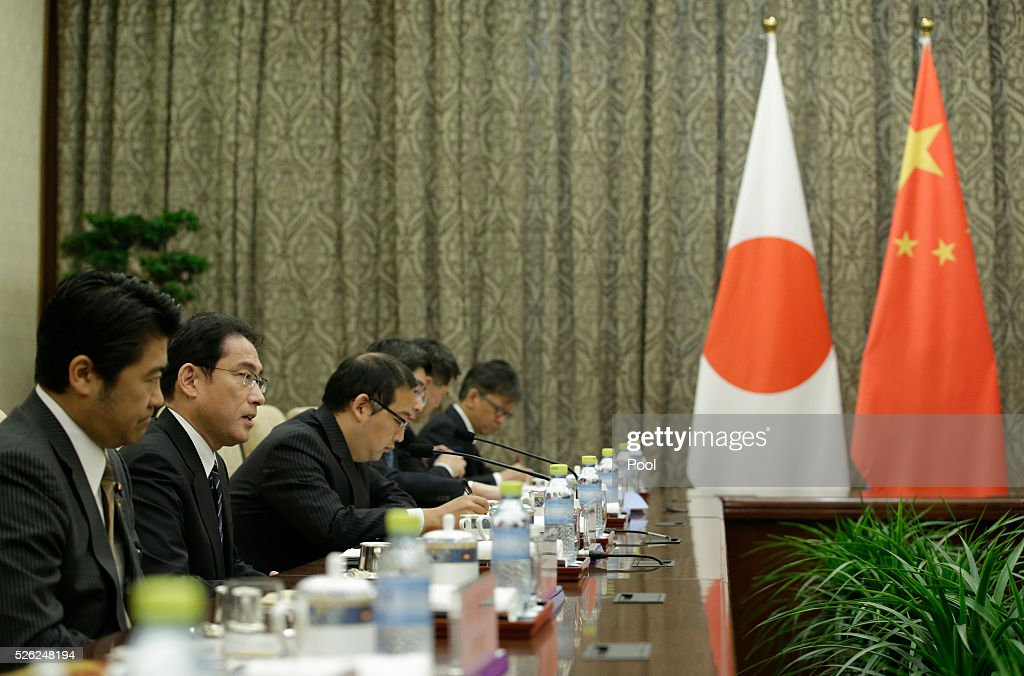 Japanese Foreign Minister Fumio Kishida (2nd L) talks with China's Foreign Minister Wang Yi (not pictured) during a meeting at Diaoyutai State Guesthouse April 30, 2016 in Beijing, China.