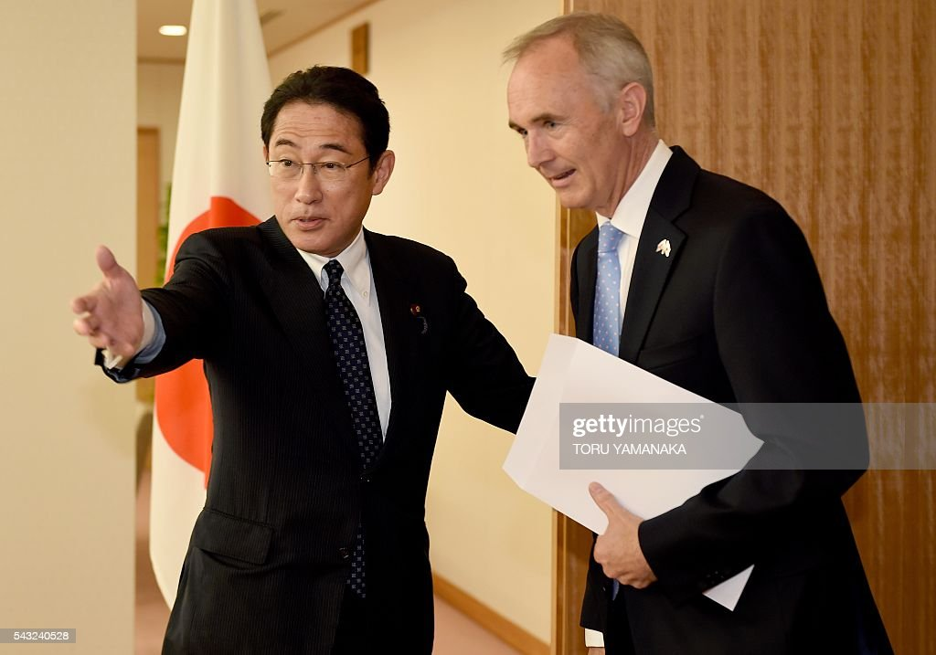 Japanese Foreign Minister Fumio Kishida (L) welcomes British Ambassador to Japan Timothy Mark Hitchens (R) prior to their talks at Kishida's office in Tokyo on June 27, 2016. Kishida and Hitchens met to talk on Britain's vote to quit the European Union. / AFP / TORU