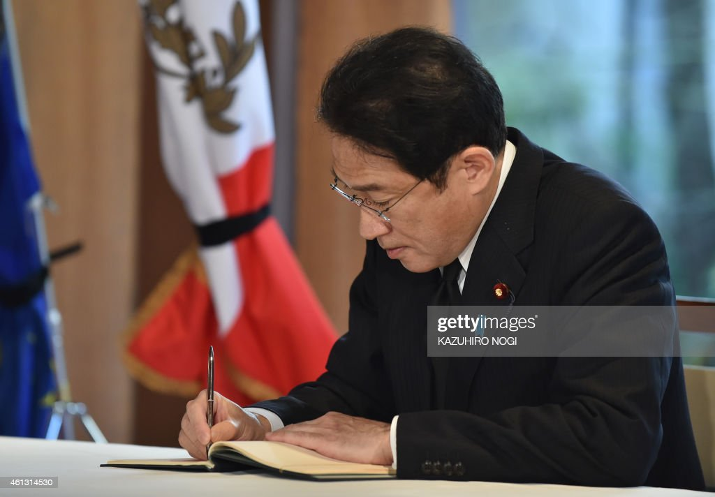 Japanese Foreign Minister <a gi-track='captionPersonalityLinkClicked' href=/galleries/search?phrase=Fumio+Kishida&family=editorial&specificpeople=10093794 ng-click='$event.stopPropagation()'>Fumio Kishida</a> writes a message in a condolence book at the French Ambassador to Japan Thierry Dana's residence in Tokyo on January 11, 2015. Kishida visited the French ambassador's residence to convey his condolences on the terror attack by gunmen on the French satirical weekly Charlie Hebdo in Paris. AFP PHOTO / KAZUHIRO NOGI