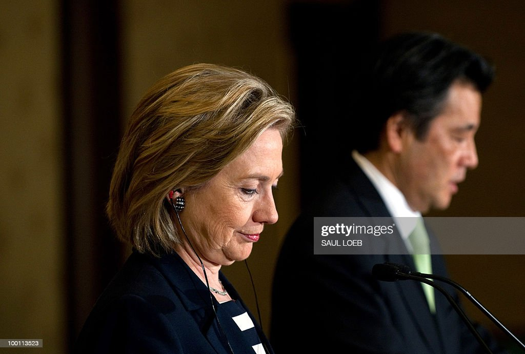 Japanese Foreign Minister Katsuya Okada (R) and US Secretary of State Hillary Clinton (C) hold a joint press conference following meetings at the Iikura Guest House. Clinton and her Japanese counterpart condemned North Korea, a day after a multinational panel blamed it for a deadly torpedo attack on a South Korean warship. AFP PHOTO/POOL/Saul LOEB