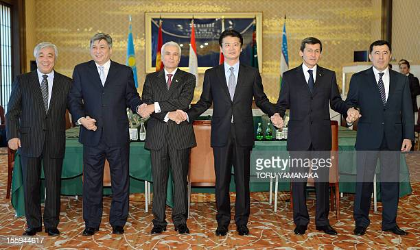 Japanese Foreign Minister Koichiro Gemba and other foreign ministers from central Asian countries join their hands prior to their biennial meeting in...