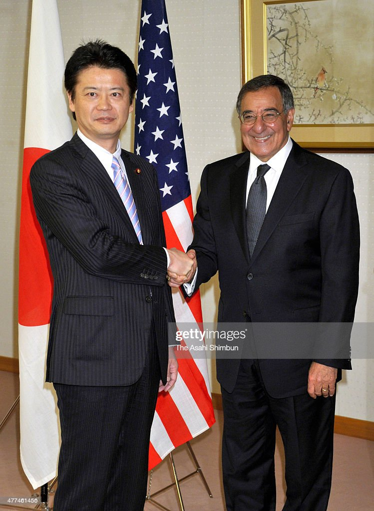 Japanese Foreign Minister <a gi-track='captionPersonalityLinkClicked' href=/galleries/search?phrase=Koichiro+Gemba&family=editorial&specificpeople=7046304 ng-click='$event.stopPropagation()'>Koichiro Gemba</a> and U.S. Defense Secretary Leon Panetta shake hands during their meeting at Foreign Ministry on October 25, 2011 in Tokyo, Japan.