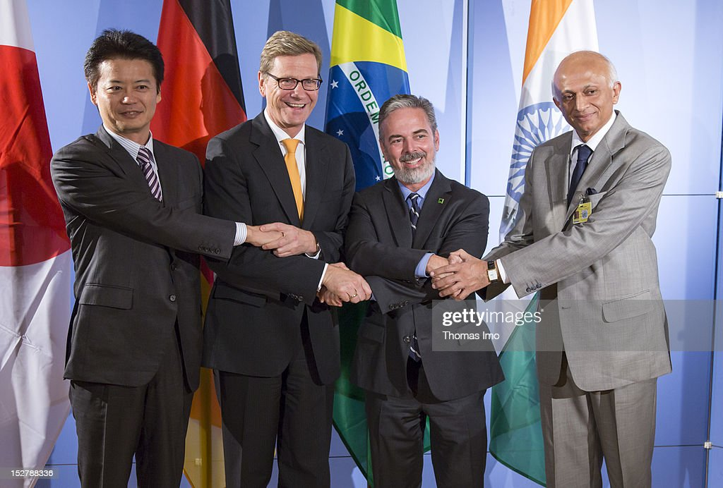 Japanese Foreign Minister <a gi-track='captionPersonalityLinkClicked' href=/galleries/search?phrase=Koichiro+Gemba&family=editorial&specificpeople=7046304 ng-click='$event.stopPropagation()'>Koichiro Gemba</a>, German Foreign Minister <a gi-track='captionPersonalityLinkClicked' href=/galleries/search?phrase=Guido+Westerwelle&family=editorial&specificpeople=208748 ng-click='$event.stopPropagation()'>Guido Westerwelle</a>, Brazilian Foreign Minister Antonio Patriota and Foreign Minister of India, Ranjan Mathai shake hands on September 25, 2012 in New York City. The 67th General Assembly session opened today, with over 120 national leaders and scores of foreign ministers attending.