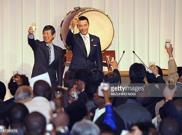 Japanese Foreign Minister Masahiko Komura and Yokohama City Mayor Hiroshi Nakata propose a toast during a welcome reception ahead of the Tokyo...