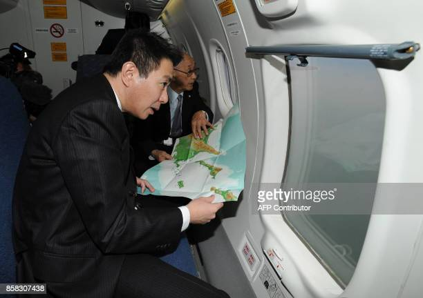 Japanese Foreign Minister Seiji Maehara in a Japan Coast Guard airplane inspects the four disputed Russianheld Kuril islands known as Northern...