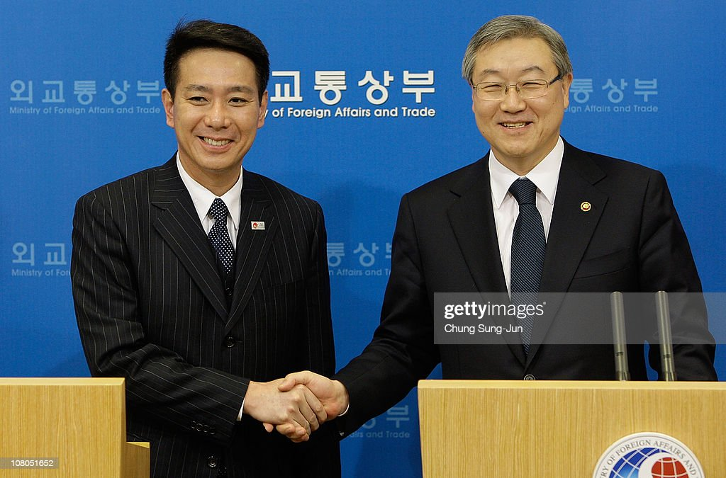 Japanese Foreign Minister Seiji Maehara shakes hands with South Korean Foreign Minister Kim SungHwan after their joint press conference at Foreign...