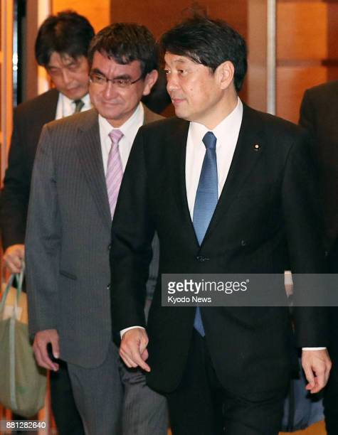 Japanese Foreign Minister Taro Kono and Defense Minister Itsunori Onodera leave the prime minister's office in Tokyo on Nov 29 2017 after a meeting...