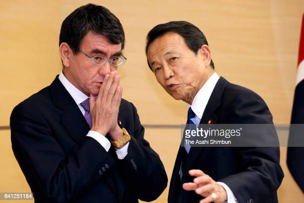 Japanese Foreign Minister Taro Kono and Deputy Prime Minister Taro Aso talk prior to a National Security Council meeting which British Prime Minister...