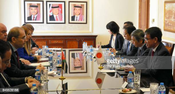 Japanese Foreign Minister Taro Kono and Jordani Foreign Minister Ayman Safadi talk during their meeting at the Foreign Ministry on September 10 2017...